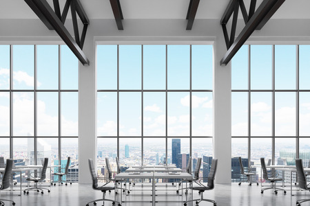 company premises: Modern workplaces in a modern bright clean interior of a loft style office. Huge windows with New York panoramic view. White desks equipped with laptops, black leather chairs. 3D rendering.