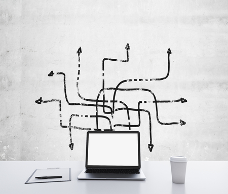multidirectional: A laptop with white screen, a writing pad and a cap of coffee are on the white table. Several arrows are drawn on the concrete wall in different directions. A concept of multitasking. 3D rendering.