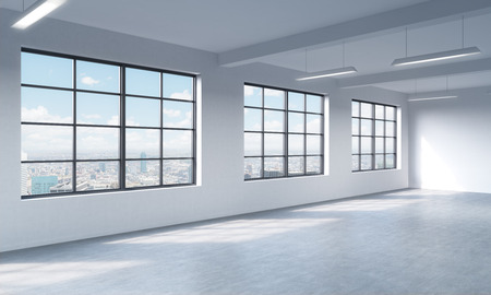 Loft style open space can be used wether office space or residential one. 3D rendering. Huge windows. White walls. New York City view. Stock Photo