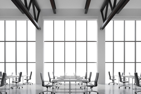 company premises: Modern workplaces in a modern bright clean interior of a loft style office. Huge windows with copy space and white walls. White desks equipped with laptops, black leather chairs. 3D rendering.