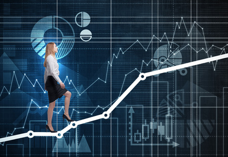 corporate ladder: A business lady is going up the graph as a concept of corporate ladder. Financial charts are drawn on the wall.