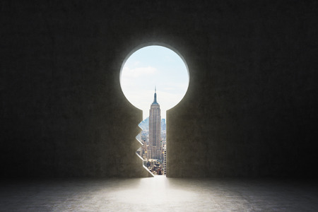 A keyhole in the concrete wall. New York City view in the hole.