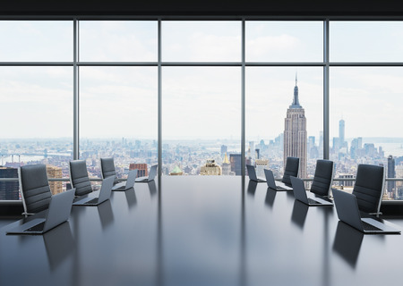 A conference room equipped by modern laptops in a modern panoramic office in New York. Black leather chairs. 3D rendering.