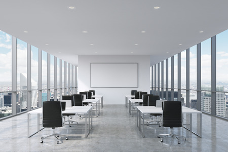 interior office: A symmetric corporate workplaces equipped by modern laptops in a modern panoramic office in New York City. Black leather chairs and a white tables, a huge whiteboard on the wall. 3D rendering. Stock Photo