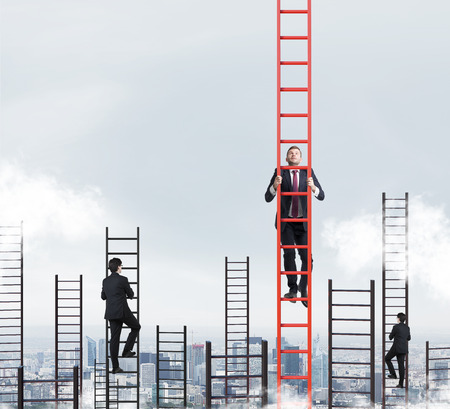 A concept of competition, and problem solving. Several businessmen are racing to achieve the highest point using ladders. New York city view. Archivio Fotografico
