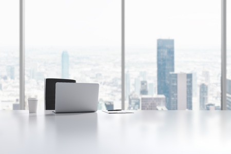 new york city panorama: A workplace in a modern panoramic office in Manhattan, New York City. A laptop, notepad and a coffee cup are on the white table. 3D rendering. Stock Photo