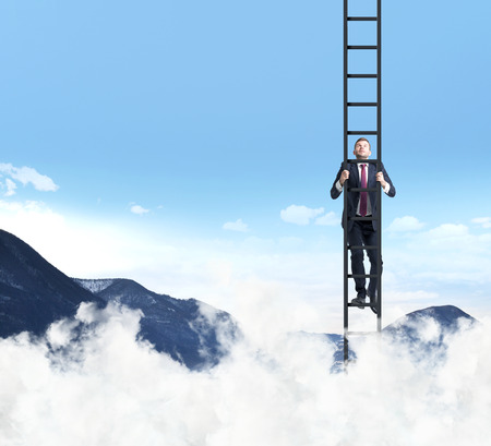 A businessman is climbing up the ladder. Clouds and mountain landscape. The concept of the success.