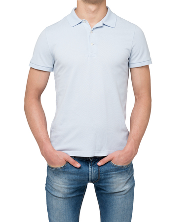 tee shirt: Man wearing light blue polo shirt and denims. Hands are in the pockets. isolated on white background. Stock Photo