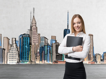 legal services: Young beautiful business lady is holding a black document case. A concept of legal services. New York stretch on the background.
