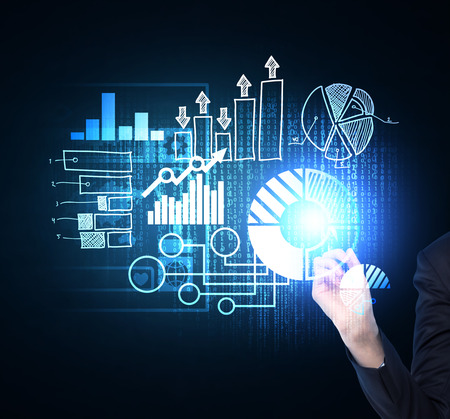 business analysis: Close up of womans hand which is pushing out the element on the hologram with business icons. Dark background.
