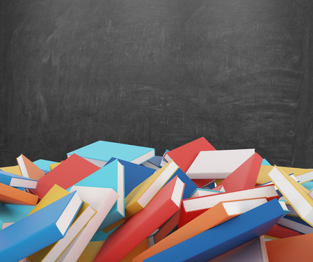 tomes: A heap of different books with colorful covers which are laying on the floor. Black chalk board on the background.