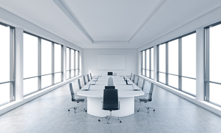 A bright modern panoramic meeting room in a modern office with white copy space in windows. The concept of the meeting of the Board of Director of the huge transnational corporation. 3D rendering. Stock Photo