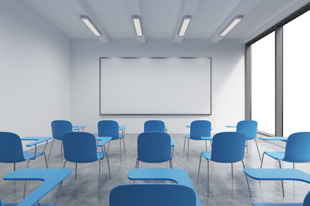 panoramic windows: A classroom or presentation room in a modern university or fancy office. Blue chairs, a whiteboard on the wall and panoramic windows with white copy space. 3D rendering. Stock Photo