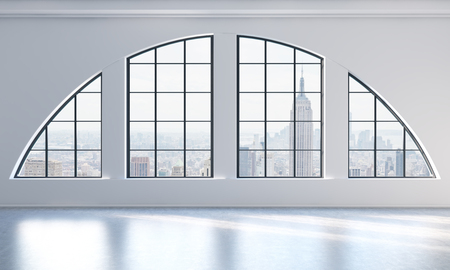 An empty modern bright and clean loft interior. New York city view. A concept of luxury open space for commercial or residential purposes. 3D rendering. Stock Photo