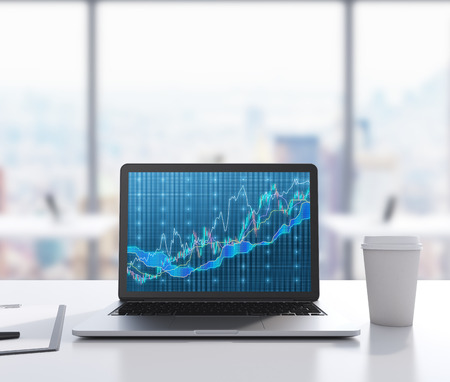 There are a laptop with forex chart on the screen, legal pad and a cup of coffee on the table. A modern workplace. 3D rendering. Modern office with panoramic New York view in blur on the background.