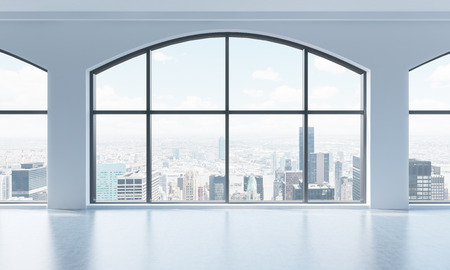 view of an atrium in a building: An empty modern bright and clean loft interior. Huge panoramic windows with New York city view. A concept of luxury open space for commercial or residential purposes. 3D rendering. Stock Photo