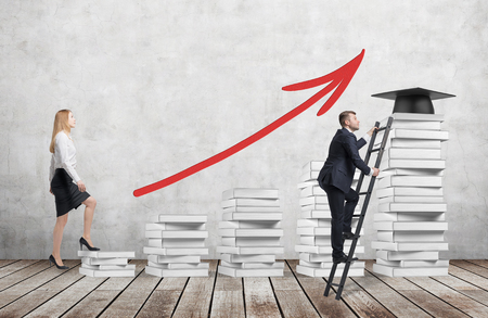 A woman is going up using a stairs which are made of white books to reach graduation hat while a man has found a shortcut to get education. A red arrow is drawn on the concrete wall. Stock Photo