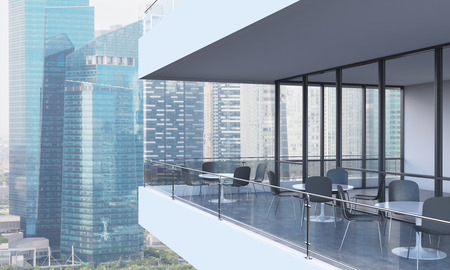 architectural firm: A woman is looking at Singapore standing on the terrace in a modern skyscraper with panoramic windows. Stock Photo