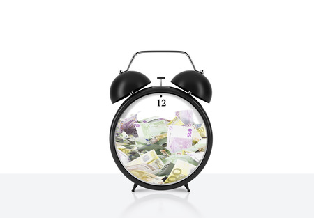 streamlining: There is EURO bills inside the alarm clock which is on the table. The concept of time is money and a time management. White background.