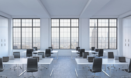 advisers: Workplaces in a bright modern open space loft office. White tables equipped with modern laptops and black chairs. New York panoramic view in the windows. 3D rendering.