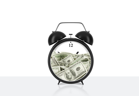 streamlining: An alarm clock with dollar bills inside is on the table. The concept of time is money and a time management. White background.