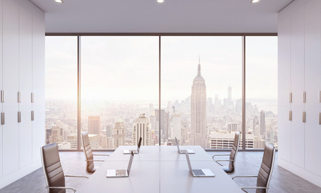 panoramic windows: Workplaces or conference area in a bright modern open space office. White tables equipped by modern laptops and black chairs. New York view. 3D rendering. A sunset. Toned image.