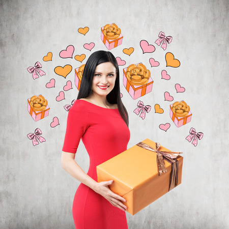 giftwrapped: A brunette in red dress holds an orange gift box. Gift and heart icons are drawn on the concrete wall.