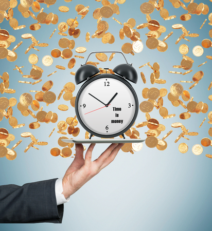 streamlining: A hand holds a tablet with alarm clock. Golden coins are falling down from the ceiling. The concept of time is money. Light blue background.