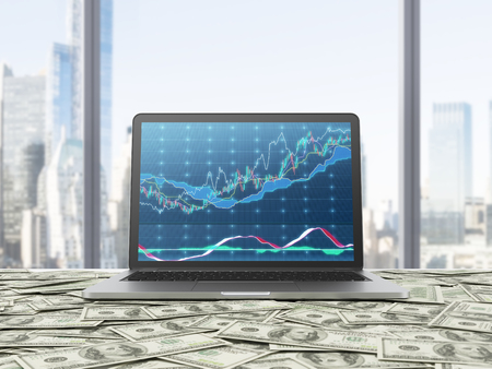 dollars: A modern laptop with forex chart on the screen. The laptop is on the table which is covered by dollar notes. New York panoramic view from the office. 3D rendering.