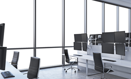 traders: A modern traders workplaces in a bright modern open space office. White tables equipped with modern traders stations and black chairs. White copy space in the panoramic windows. 3D rendering.