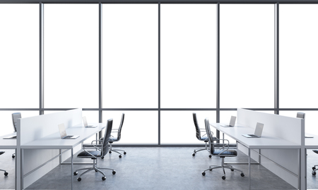 advisers: Workplaces in a bright modern open space office. White tables equipped with modern laptops and black chairs. White copy space in the panoramic windows. 3D rendering. Stock Photo