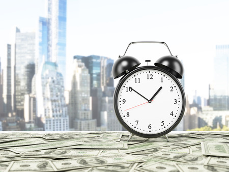 denominational: An alarm clock is settled on the surface which is covered by dollar notes. New York panorama on background. 3D rendering.