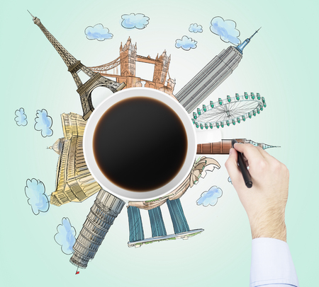 famous cities: Top view of a coffee cup and the hand draws colourful sketches of the most famous cities in the world. The concept of travelling. London, Singapore, Pisa, Paris. Light green background.