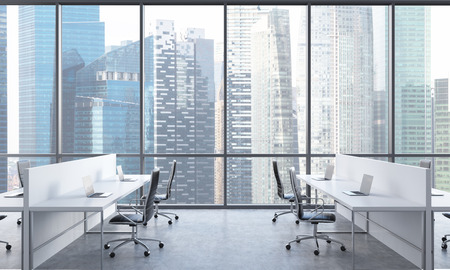 Workplaces in a bright modern open space office. White tables equipped with modern laptops and black chairs. Singapore in the panoramic windows. 3D rendering. Stock Photo