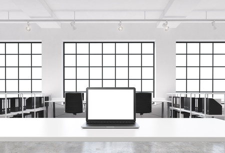 advisers: A workplace in a bright modern loft open space office. A working desk is equipped with a modern laptop with white copy space in the screen. Docs shelves. White copy space in the windows. 3D rendering.