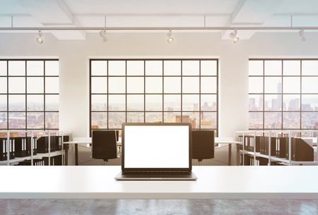 docs: A workplace in a bright modern office. A working desk is equipped with a modern laptop with white copy space in the screen. Docs shelves. New York view in the windows. Toned image. 3D rendering.