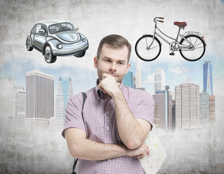disadvantages: A handsome man in casual shirt is trying to chose the most suitable way for travelling or commuting in the city. Sketches of a car, a bicycle and New York city are on the concrete background.