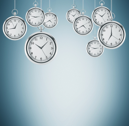 streamlining: Several models of pocket watches which are hovering in the air. A concept of a value of time in business. Light blue background. 3D rendering. Stock Photo