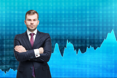 buy shares: businessman  with hands crossed standing in front of a blue graph demonstrating growth, fluctuations, concept of analysis, singapore at the background