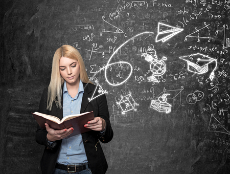alumni: a young girl standing at a wall reading a book, blackboard with science icons at the background, a concept of choice and studying