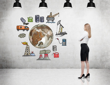 disaster supplies: a woman standing in front of the wall thinking about oil production and pollution, coloured illustration of oil industry components on a black wall arranged in a circle, concept of pollution