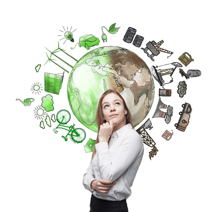 monopoly: woman in front of the wall thinking about oil production and pollution, brown illustration of oil industry components and green eco energy on white wall arranged in circle, concept of environment
