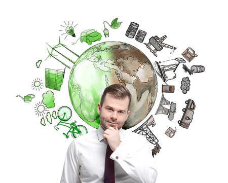 disaster supplies: man in front of the wall thinking about oil production and pollution, brown illustration of oil industry components and green eco energy on white wall arranged in circle, concept of environment