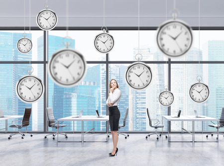 vintagel: Woman standing and thinking, several models of pocket watches hovering in the air. A concept of a value of time in business. Office in Singapore at the background.
