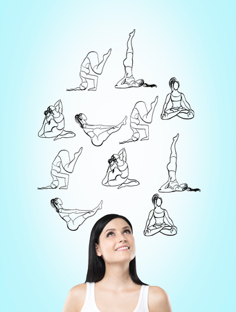 Woman with eyes raised to the top dreaming about taking up sport exercise, yoga, illustrations of several exercises over her head, concept of healthy life