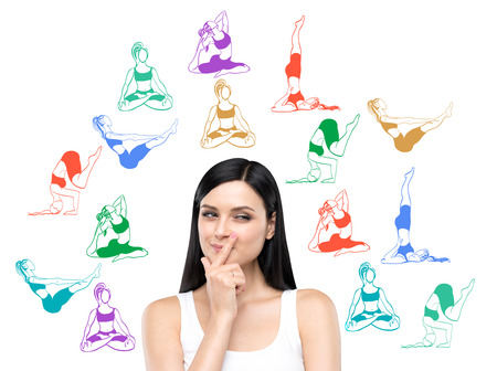 happy woman: Woman with eyes raised to the top dreaming about taking up sport exercise, yoga, coloured illustrations of several exercises around her, white background, concept of healthy life