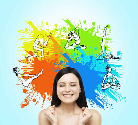 Woman with clenched fists and eyes closed tight dreaming about taking up sport exercise, yoga, illustrations of several exercises on wall with bright splashes over her head, concept of healthy life