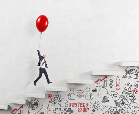 businessman in a suit flying happily holding a balloon over carrer ladder, signs career alternatives under the stairs, concept of success and career growth Stock Photo
