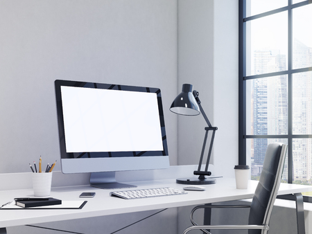 note pad and pen: workplace in the corner, blank computer, keyboard, mouse, smartphone, lamp, note pad, pen, pencil glass, coffee on the table, chair in front, window with Singapore view to the right. Concept of work