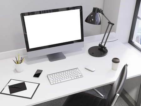 note pad and pen: workplace in the corner, blank computer, keyboard, mouse, smartphone, lamp, note pad, pen, pencil glass, coffee on the table, chair in front, window with New York view to the right. Concept of work Stock Photo